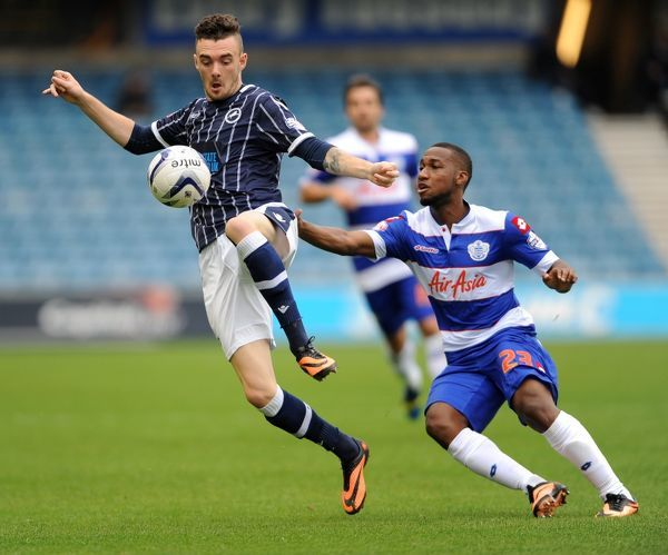 Millwalls' Scott Malone (left) and Queens Park Rangers' Junior Hoilett in action