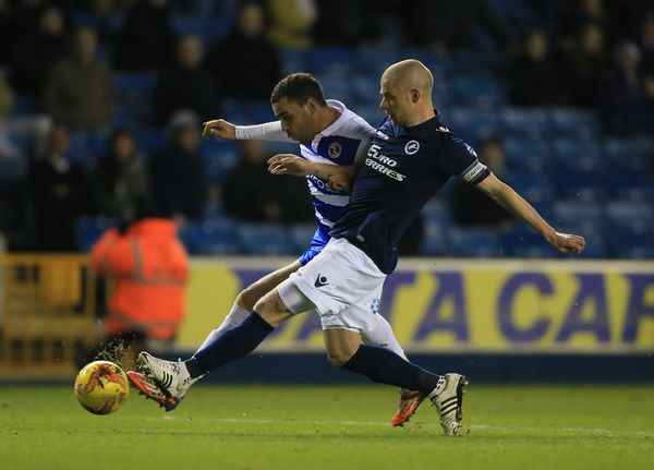 Millwall's Alan Dunne (right) and Reading's Hal Robson-Kanu battle for the ball
