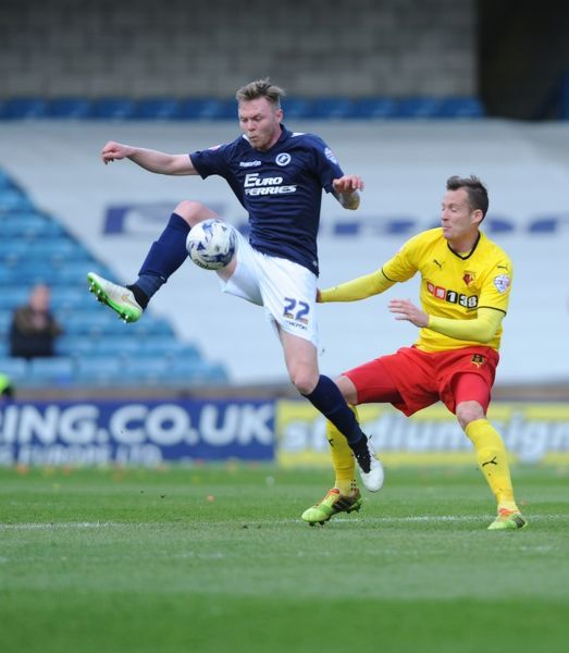 Millwall's Aiden O'Brien (left) and Watford's Daniel Tozser during the Sky Bet Championship match at The New Den, London
