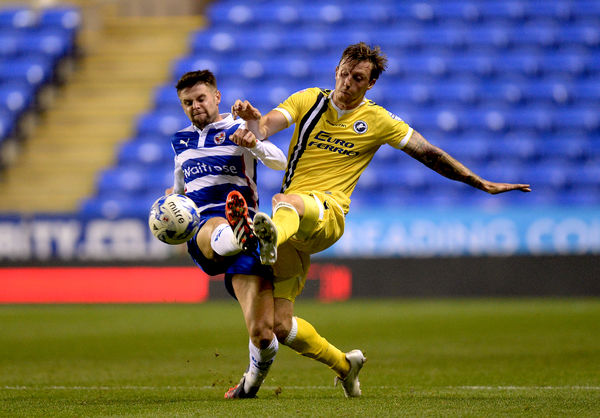 Reading's Oliver Norwood and Millwall's Martyn Woolford (right) battle for the ball