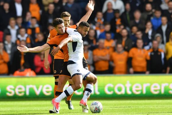 Wolverhampton Wanderers' Ben Marshall and Millwall's James Meredith compete for possession