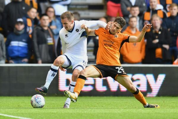 Wolverhampton Wanderers' Rueben Vinagre and Millwall's Jed Wallace compete for possession
