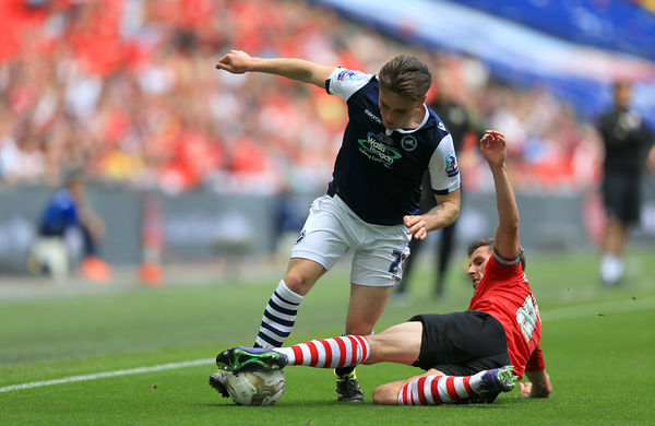 Millwall's Ben Thompson (left) and Barnsley's Conor Hourihane battle for the ball during the Sky Bet League One Play-Off Final at Wembley Stadium, London