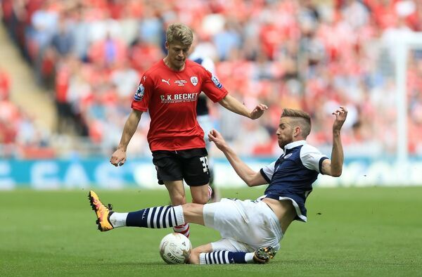 Barnsley's Lloyd Isgrove (left) and Millwall's Mark Beevers battle for the ball during the Sky Bet League One Play-Off Final at Wembley Stadium, London. PRESS ASSOCIATION Photo. Picture date: Sunday May 29, 2016. See PA story SOCCER League One
