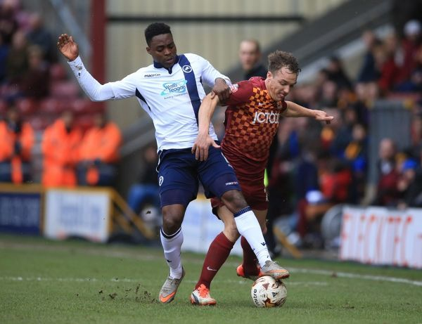 Bradford City's Tom McMahon (right) and Millwall's Fred Onyedinma battle for the ball