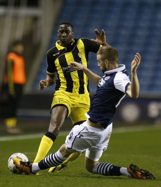 Burton Albion's Lucas Akins is tackled by Millwall's Mark Beevers the Sky Bet League One match at the New Den, London
