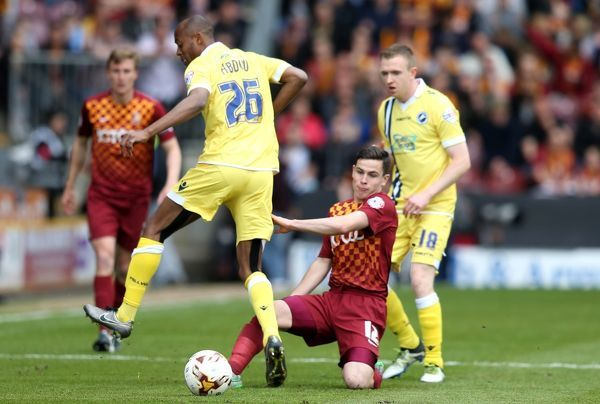 Bradford City's Josh Cullen (centre) and Millwall's Nadjim Abdou (left) and Shane Ferguson battle for the ball