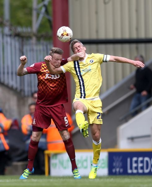 Millwall's Steve Morison (right) and Bradford City's Nathan Clarke (left) battle for the ball in the air