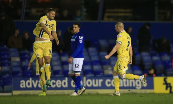 Millwall's Jos Hooiveld celebrates at end of game with captain Millwall's Alan Dunne after 1.0 win as Birmingham City's Lee Novak shows his dejection
