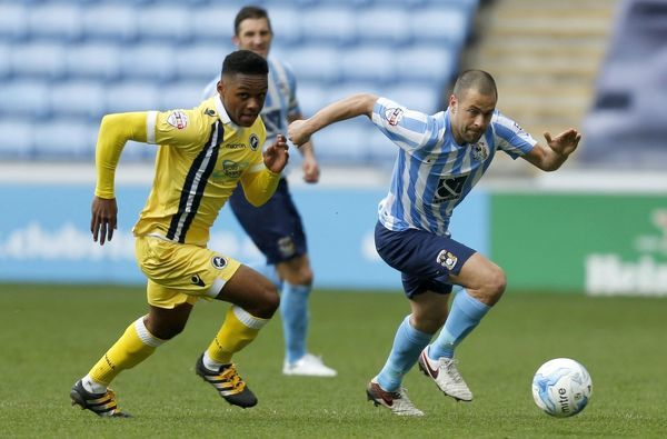 Millwall's Mahlen Romeo (left) and Coventry City's Joe Cole in action
