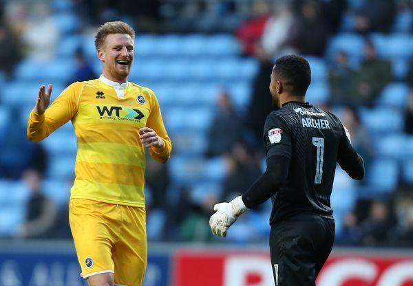Millwall's Byron Webster celebrates the second goal against Coventry with keeper Jordan Archer