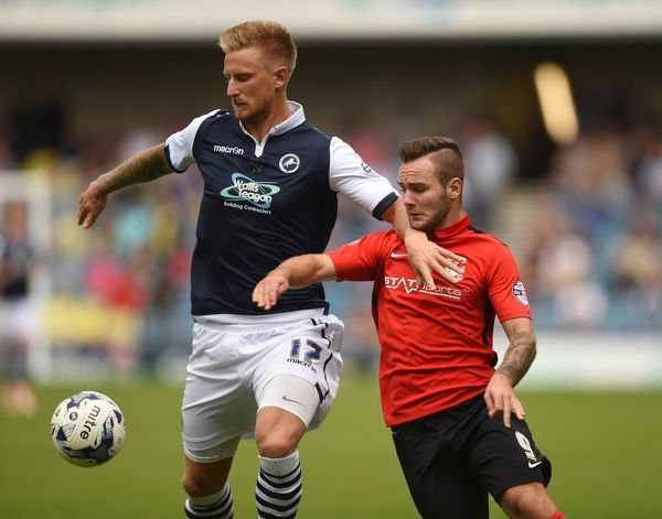 Millwall's Byron Webster and Coventry City's Adam Armstrong battle for the ball