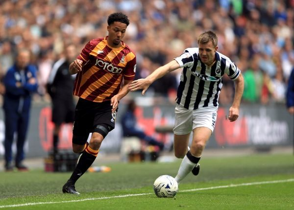 Bradford City's Timothee Dieng (left) and Millwall's Tony Craig battle for the ball during the Sky Bet League One play off final at Wembley Stadium, London