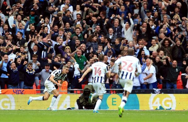 Millwall's Steve Morison celebrates scoring his side's first goal of the game during the Sky Bet League One play off final at Wembley Stadium, London