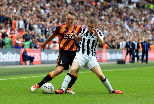 Bradford City's Tony McMahon (left) and Millwall's Shane Ferguson battle for the ball during the Sky Bet League One play off final at Wembley Stadium, London