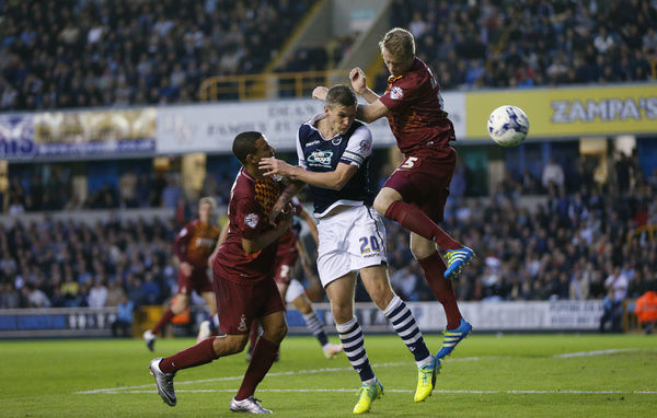 Millwall's Steve Morison (centre) and Bradford City's James Meredith (left) and Nathan Clarke (right)