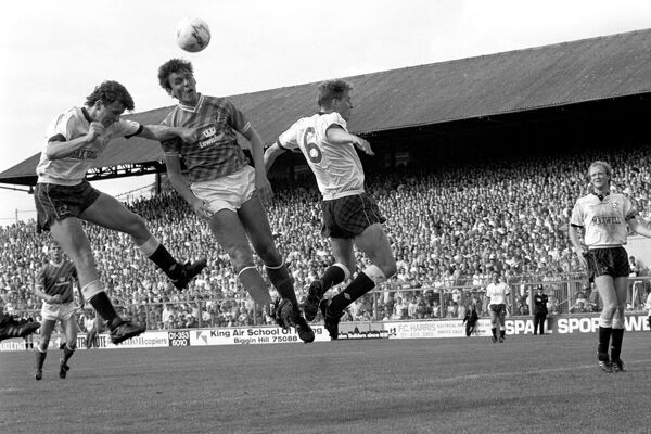 Tony Cascarino (centre), flanked by Derby's Michael Forsyth (left) and Paul Blades, heads the ball