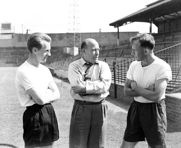 New Millwall manager James 'JR' Smith (c) talks to two of his charges, Ron Heckman (l) and Alf Ackerman (r), during pre-season training
