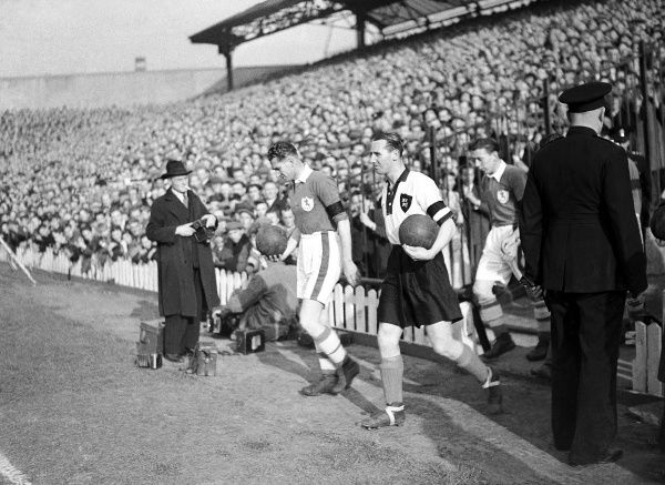 (L-R) The two captains lead their teams out before the match, Millwall's Walter McMillen and Notts County's Tommy Lawton