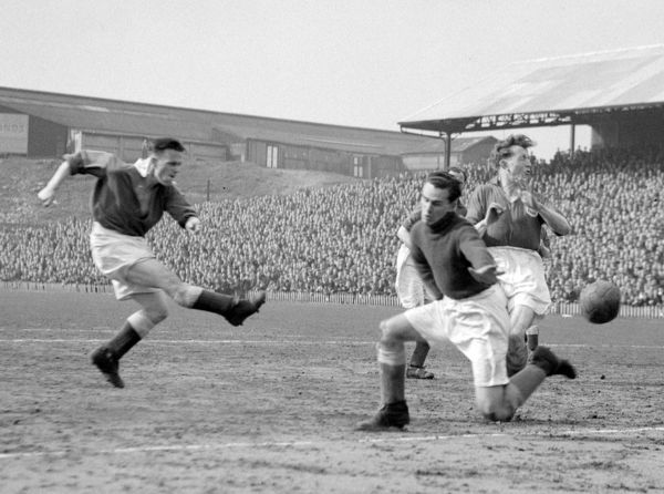 Billy Hurrell of Millwall shoots through Harry Fearnley, the Leeds United goalkeeper