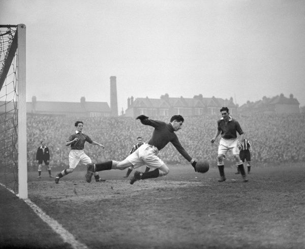 Charles Bumstead, the Millwall goalkeeper, makes a save
