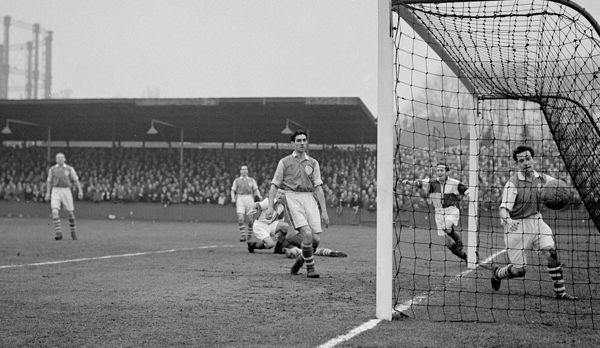 The ball sails in Millwall's net for Bristol Rovers by their inside left Geoffrey Bradford. In net is George Fisher, the Millwall left back, and in centre is Gerard Bowler, the Millwall centre half